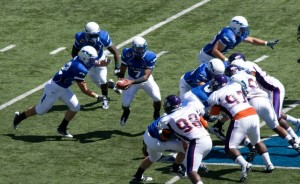 The Air Force football team runs the triple option.