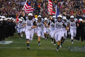 Navy Football team running on to the field carrying american flags. Football motivation at its best.